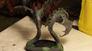 The twins have an Amphisbaena thing going on, thanks to green stuff. I'll base the model with sand to give the impression that they're slithering through the dunes.